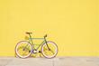 Leinwanddruck Bild - A City bicycle fixed gear on yellow wall