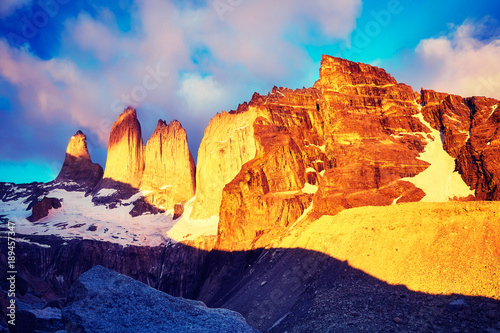 Torres del Paine famous rock formations at pink sunrise, color toned picture, Patagonia, Chile.