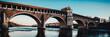 beautiful river landscape - covered bridge over Ticino river at Pavia - italian landscape panorama