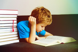 little boy reading books at home, learning - 189472355