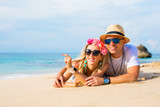 Young loving couple lying in sand on the beach