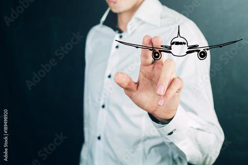 businessman holds hands aircraft
