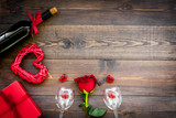 Celebrate Valentine's day. Wine, glasses, red rose, heart sign, gift box on dark wooden background top view copy space - 189509940