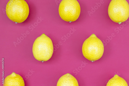 Top view of colorful fruit pattern of fresh lemon on pink background - 189515716