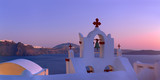 Volcanic caldera on Santorini island over the bell tower of the local church in Oia, Santorini - 189525798