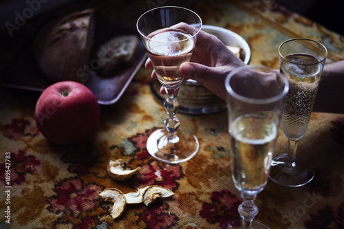 Lunch Provencal style, seasonal vegetables, fruits, champagne in glasses, daylight © olgapogorelova