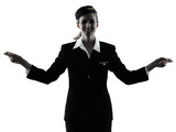 one caucasian Stewardess cabin crew  woman pointing showing isolated on white background in  silhouette - 189552798