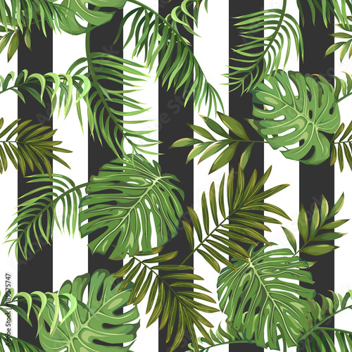 Seamless pattern with tropical palm leaves and vertical stripes
