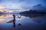 Fisherman is fishing at Baan Nong Thale in Krabi, Thailand.