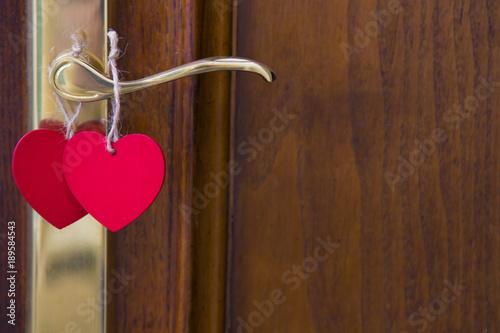 door with heart card hanging