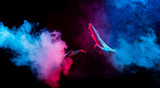 hands reaching from colorful smoke on black background - 189589763