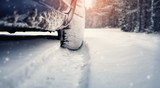 Car tires on winter road covered with snow. Vehicle on snowy way in the morning at snowfall - 189608591