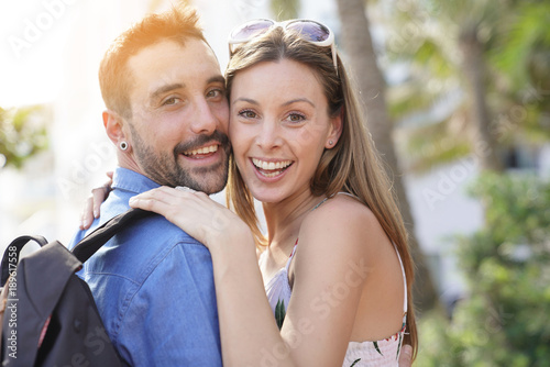 Foto Murales Cheerful young loving couple visiting South beach Miami
