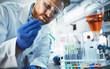 Leinwandbild Motiv Male student of chemistry working in laboratory