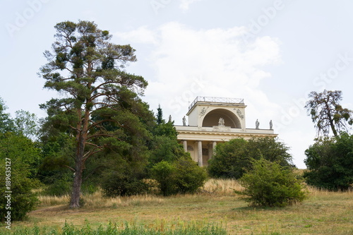 Temple of Apollo in the Lednice-Valtice cultural landscape on a hill above the pond Mlynsky, UNESCO heritage site in summer sunny day, Moravia, Czech Republic