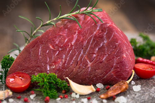 Foto op Canvas Steakhouse Raw beef meat with spices