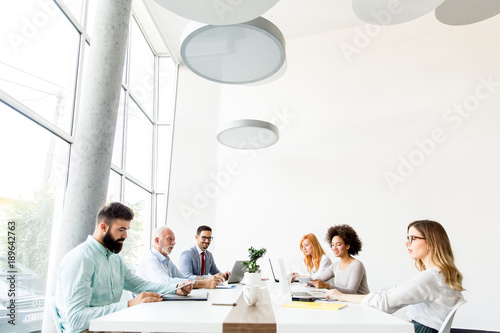 Business people around table during staff meeting