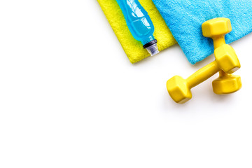 Fitness concept. Sport drink, dumbbells, towel on white background top view copy space © 9dreamstudio