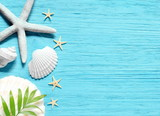 Summer sea background - shells, star on a wooden blue background - 189653746