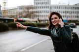 Portrait of beautiful woman hailing a cab.