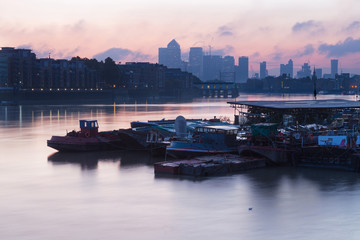 London - The ships in the pier and the Canary Wharf in morning.