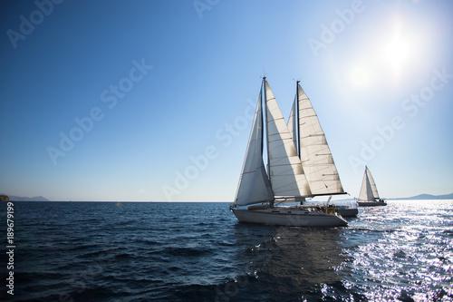 Fotobehang Zeilen Luxury yacht boats at the Sea. Sailing regatta. Cruise yachting.
