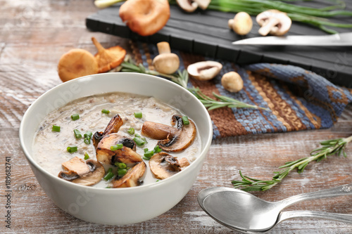 Fotobehang Kruiden 2 Bowl with delicious mushroom soup on wooden table