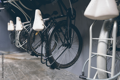 Fotobehang Fiets The rear five bicycles parked on the wall