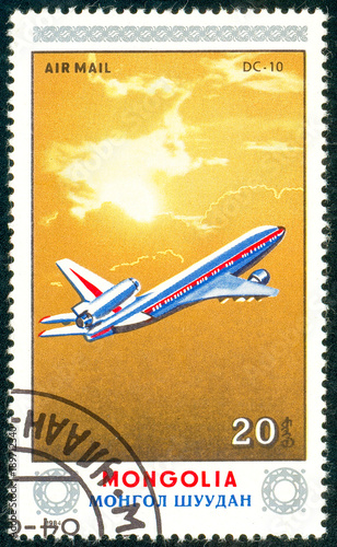 Fotobehang Schip Ukraine - circa 2018: A postage stamp printed in Mongolia show aircraft Dc-10. Series: Airplanes. Circa 1984.