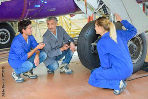 team of engineers fixing an aiplane