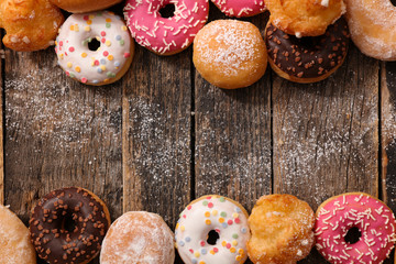 assorted donuts on wood background