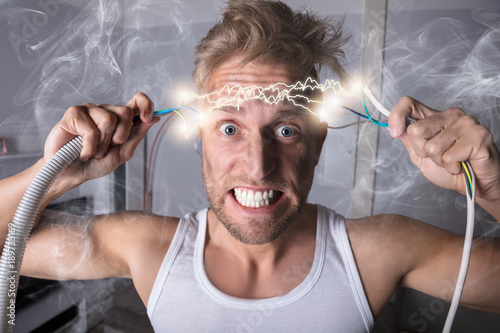 Man Holding Bared Wires