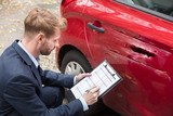 Insurance Agent Examining Car After Accident - 189745124