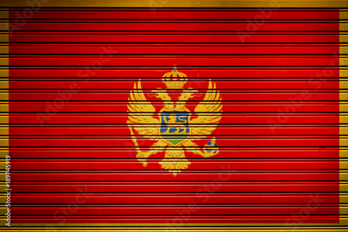 Foto op Canvas Rood traf. Montenegro Southern Europe Flag sign in iron garage door texture, flag background