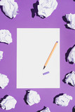 Blank white page and pen laying on violet background - 189753155