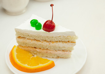 Piece of cake with a cherry