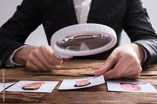Looking At Candidate's Photograph With Magnifying Glass © Andrey Popov