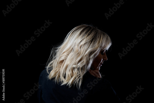 Woman With Blonde Lob Haircut on A Black Background