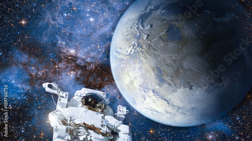 Foto op Canvas Heelal Astronaut in outer space against colorful storm galaxy and earth. (Elements of this image furnished by NASA)