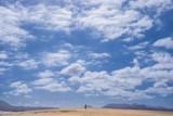 Single man walk in the fuerteventura desert - 189770515