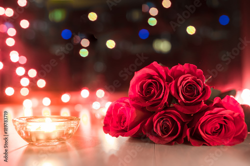Beautiful roses next to candle light.  © kieferpix