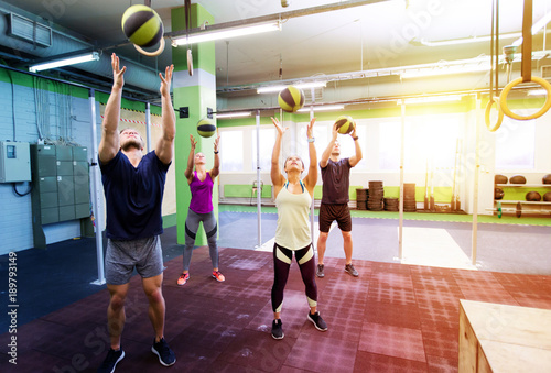 Sticker group of people with medicine ball training in gym