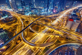 Aerial view of big highway interchange with traffic in Dubai, UAE, at night. Scenic cityscape. Colorful transportation, communications and driving background. - 189818520