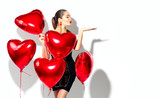 Valentine's Day. Beauty girl with red heart shaped air balloons having fun, isolated on white background - 189839717