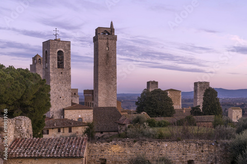 Foto Murales Delicate sunset on the towers, San Gimignano, Siena, Tuscany, Italy