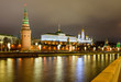 Illuminated Moscow Kremlin and Moscow river in winter evening, Russia