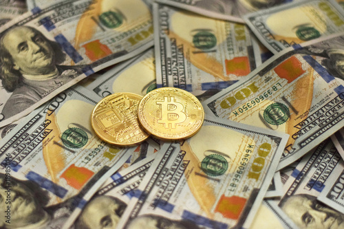 Golden Metal Bitcoin Pair and Banknotes of Dollars. Cryptocurrency Exchange Concept.