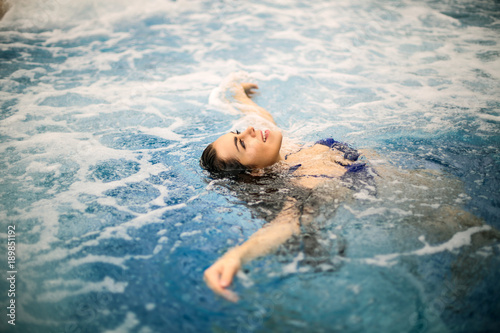 Carefree girl floating in the water
