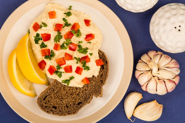 Vegetarian Snack of Hummus with Red Peppers Parsley Lemon and Rye Bread