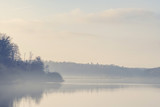 Lake scenery with morning fog and silent water - 189881728